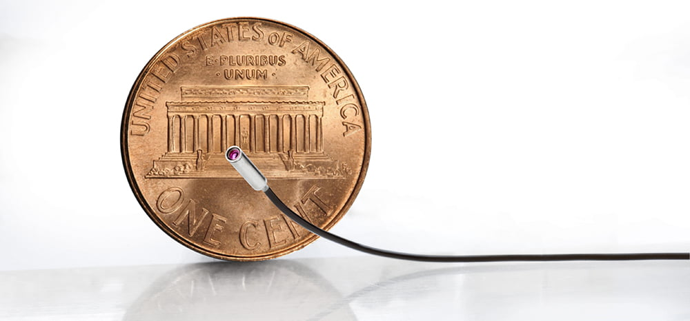 endoscope distal section including several sophisticated innovative technologies such as a surgical stapler, miniature camera and an ultrasound sensor.