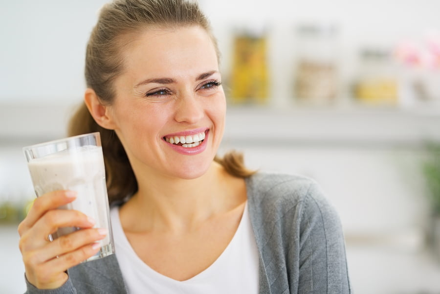 Smiling Young Woman Drinking