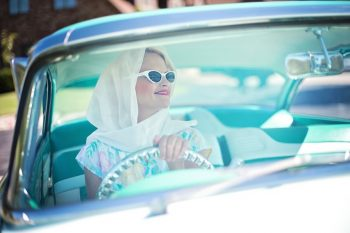 Woman driving a car. Courtesy