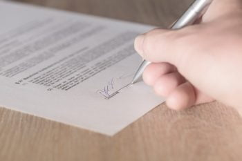 Signing a Contract via WOCinTech Chat/Flickr