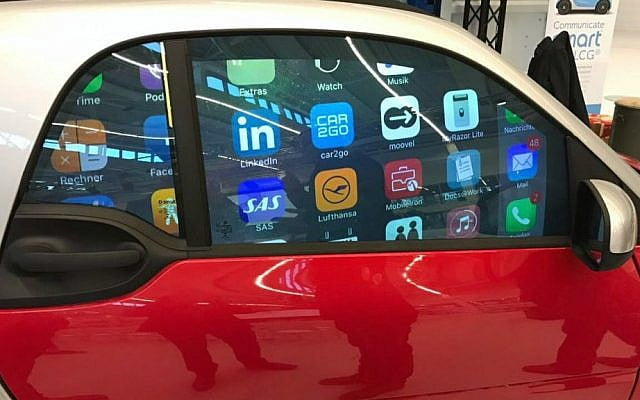 Ads projected in a car window using Gauzy's LCG technology.  Courtesy