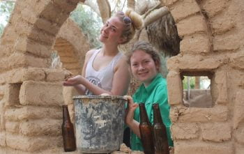 Volunteers engage in natural construction at Kibbutz Lotan. Courtesy Kibbutz Lotan Center for Creative Ecology