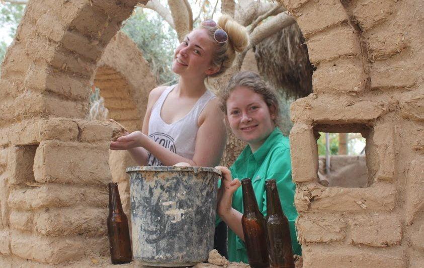 Volunteers engage in natural construction at Kibbutz Lotan. Courtesy Kibbutz Lotan Center for Creative Ecology