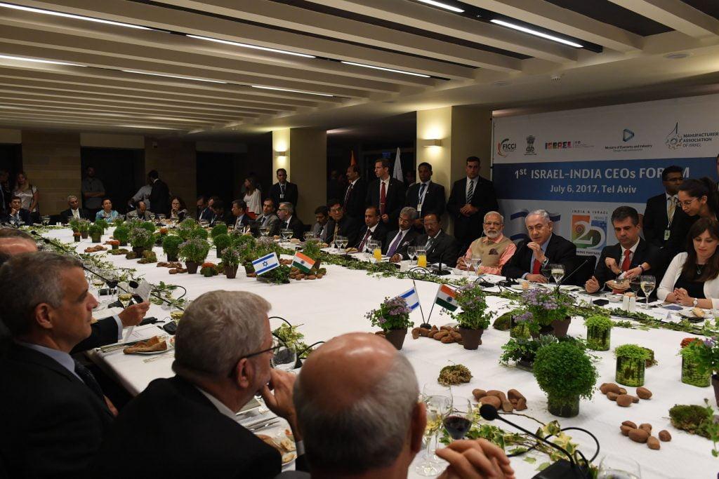 PM Netanyahu and Indian PM Narendra Modi speak with the Israeli-Indian CEOs forum, in Tel Aviv in July 2017. Photo by Kobi Gideon, GPO