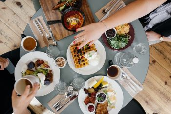 An illustrative photo of a table of food. Photo via Pixabay