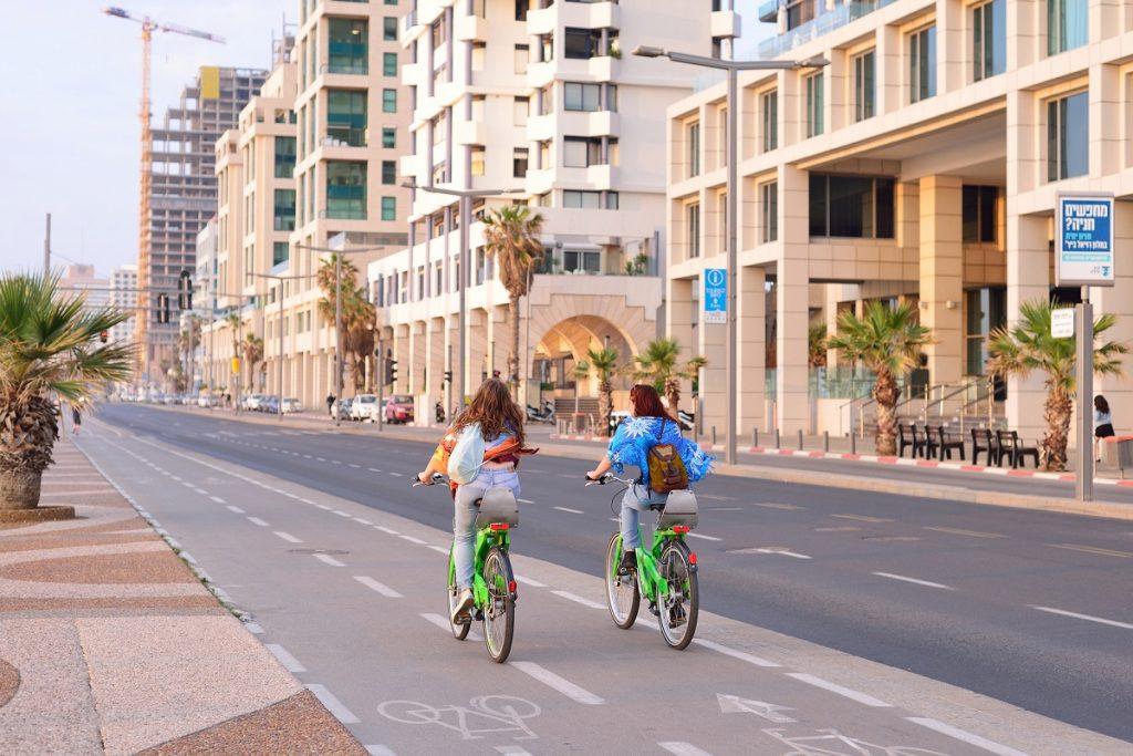 Herbert Samuel st. bike track and walking area for pedestrians in the center of Tel Aviv. Deposit Photos