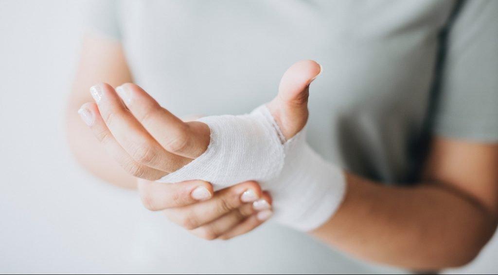 A bandaged hand. Photo via pexels.