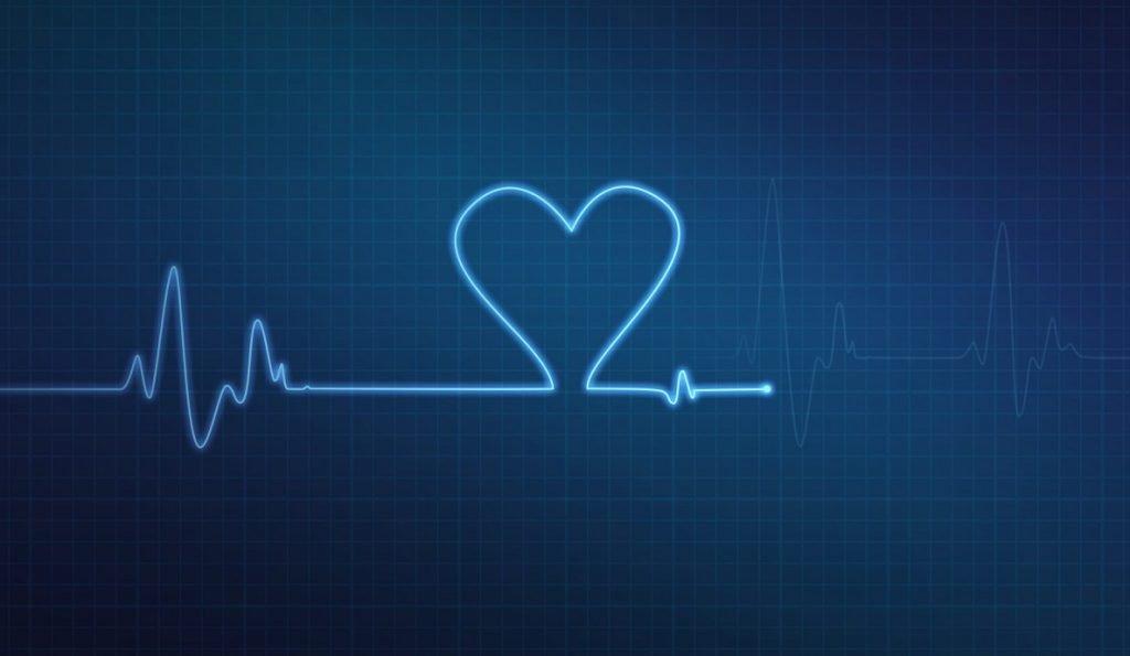 Heart-shaped blip on a medical heart monitor. Deposit photos