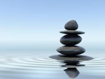 An illustrative photo of zen stones in water. Deposit Photos