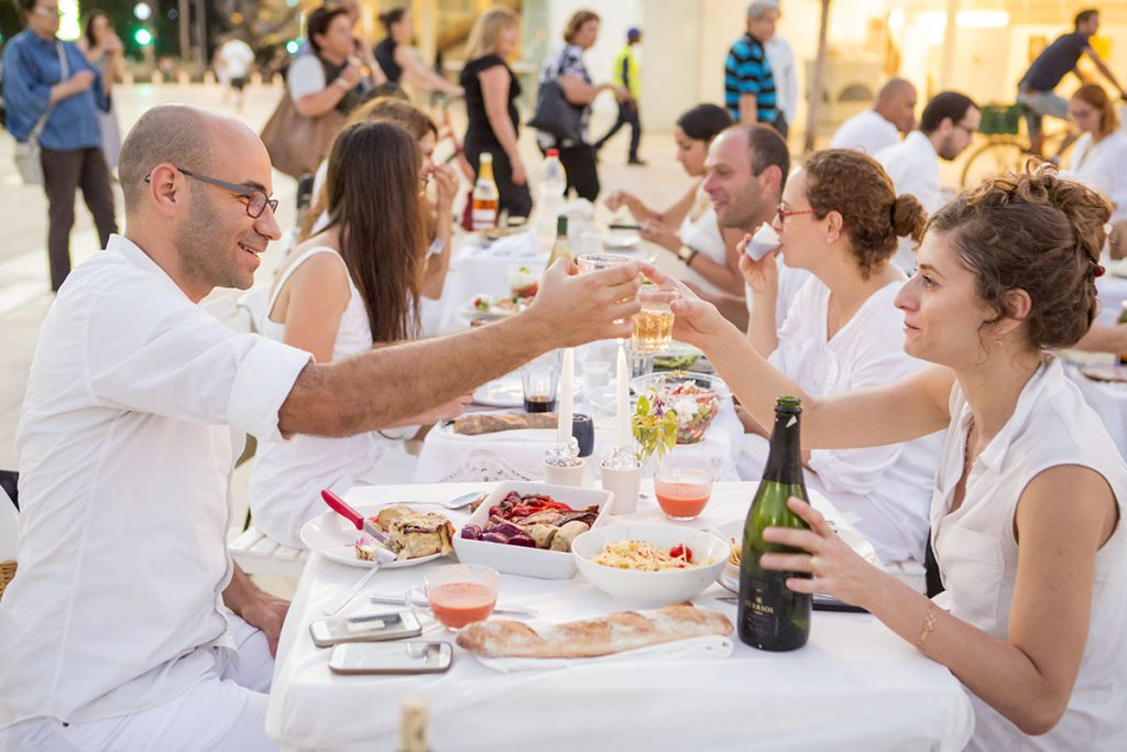A communal dinner in Tel Aviv in 2014. Photo by Kfir Bolotin