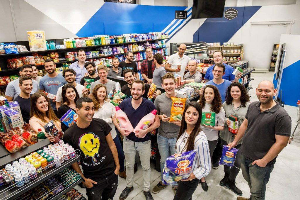 Members of the Trigo Vision team in the company's demo store. Photo via Trigo Vision's Facebook page