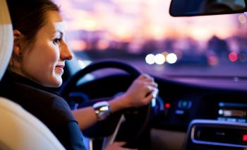 An illustrative photo of a person driving. deposit Photos