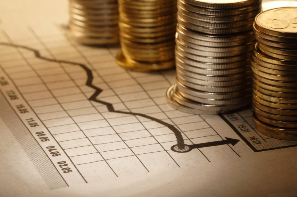 Illustrative. Coins on a chart. Deposit Photos