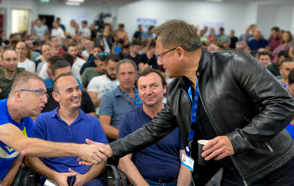 Nvidia's Jensen Huang, right, shakes hands with Mellanox staff. Photo via Nvidia