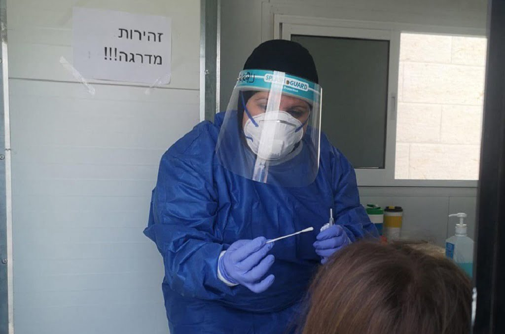A coronavirus test administered by a Clalit healthcare worker in Petah Tikva, June 2020. Photo via the Health Ministry's Telegram channel.