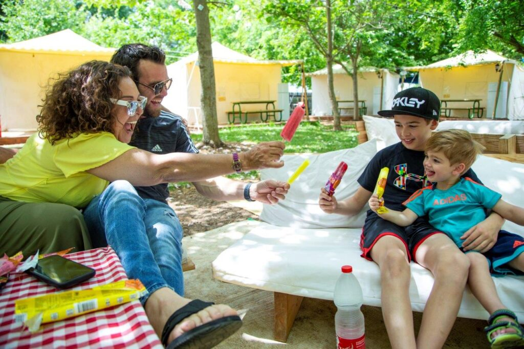 A family at a glamping site in Kfar Blum in the norther Galilee. Photo: Gilad Sasson