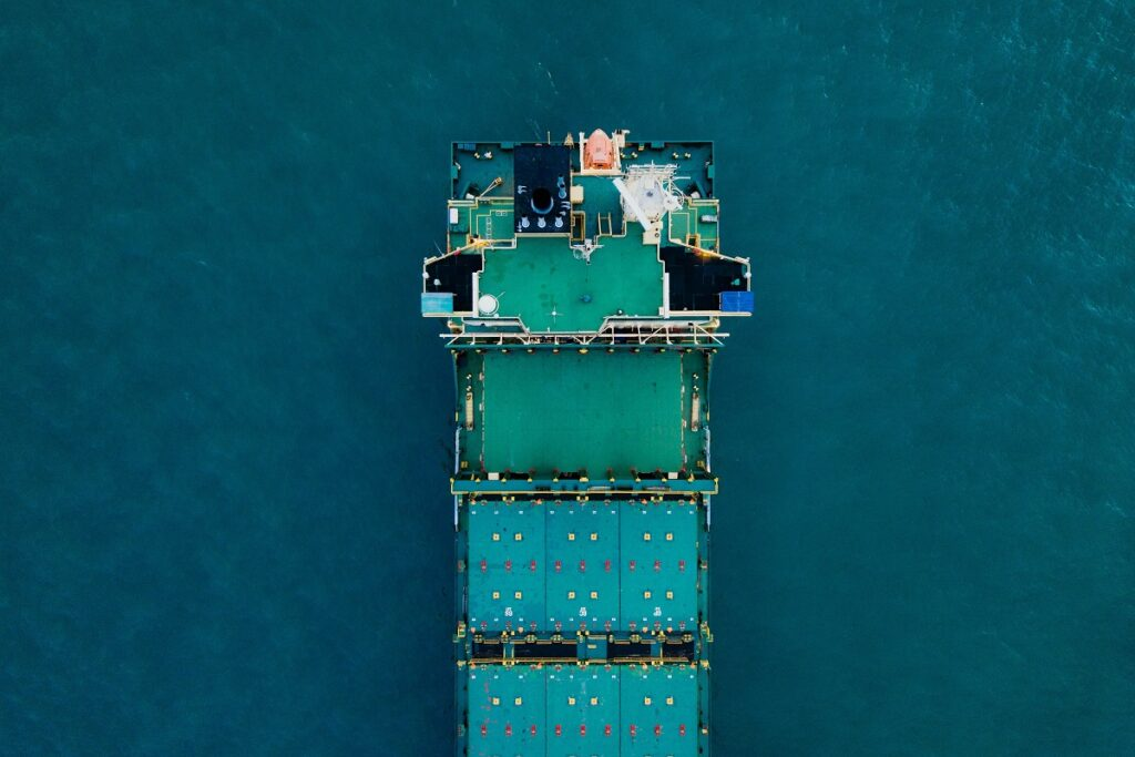 A cargo ship at sea. Photo by CHUTTERSNAP on Unsplash