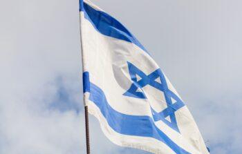 An Israeli flag. Photo by: Oleg Vakhromov on Unsplash
