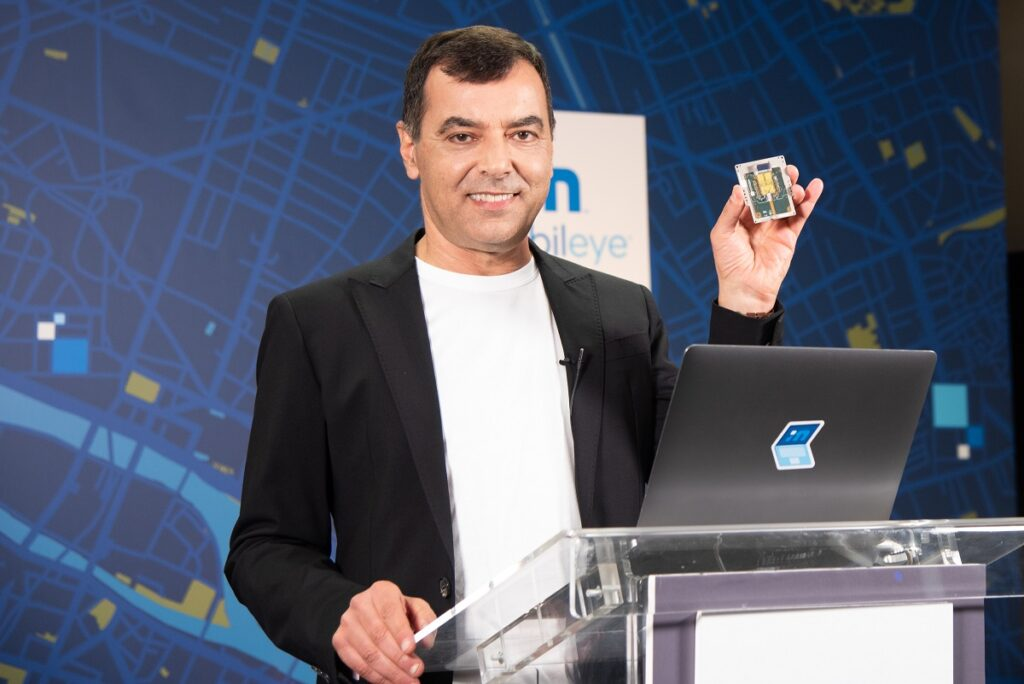 During his annual 'Under the Hood' address at the all-virtual CES 2021, Prof. Amnon Shashua, president and CEO of Mobileye, shows off a new silicon photonics lidar SoC that will deliver frequency-modulated continuous wave (FMCW) lidar on a chip for autonomous vehicles beginning in 2025. Photo: Intel Corporation
