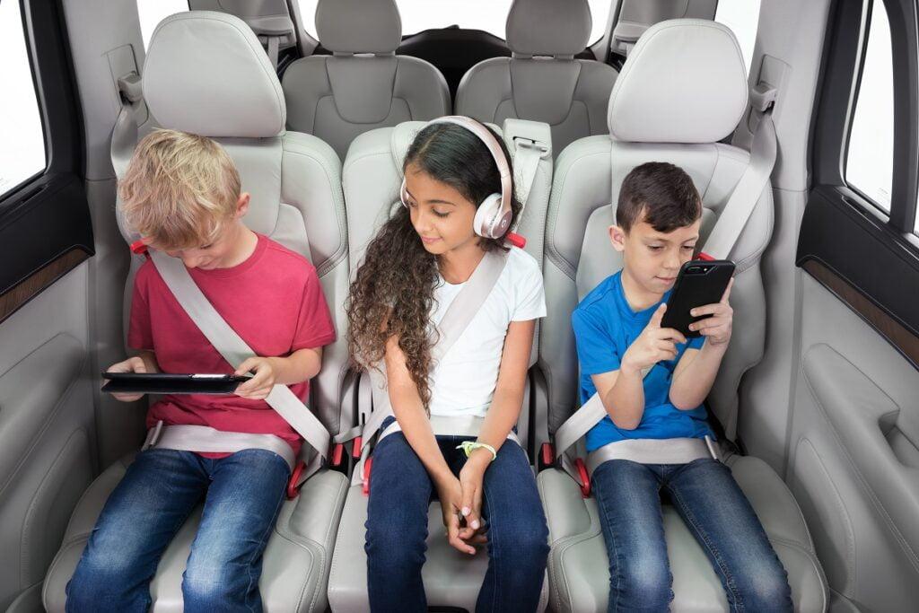 Kids sit in Carfoldio's range of compact car seats. Courtesy