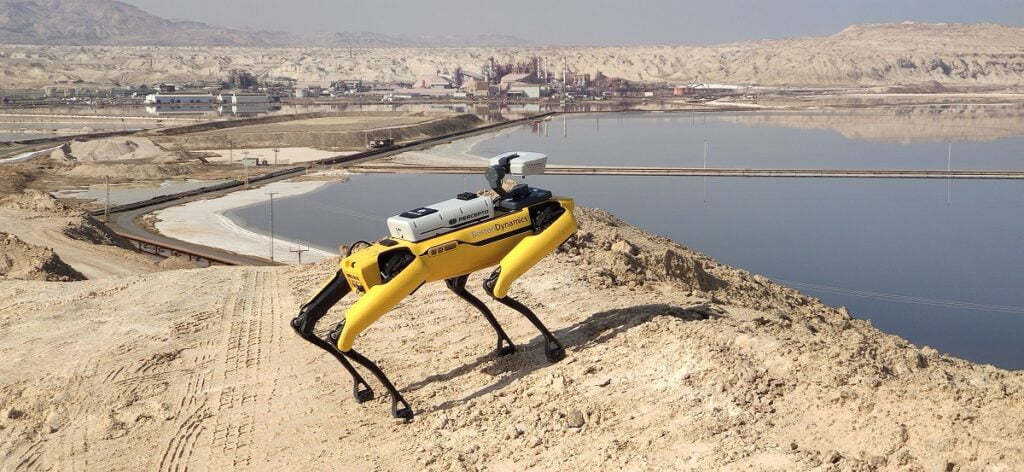 Percepto's Sparrow drone flies above Boston Dynamics' Spot robot. Courtesy