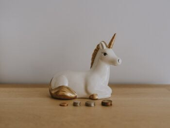 A unicorn figurine. Photo by Annie Spratt on Unsplash