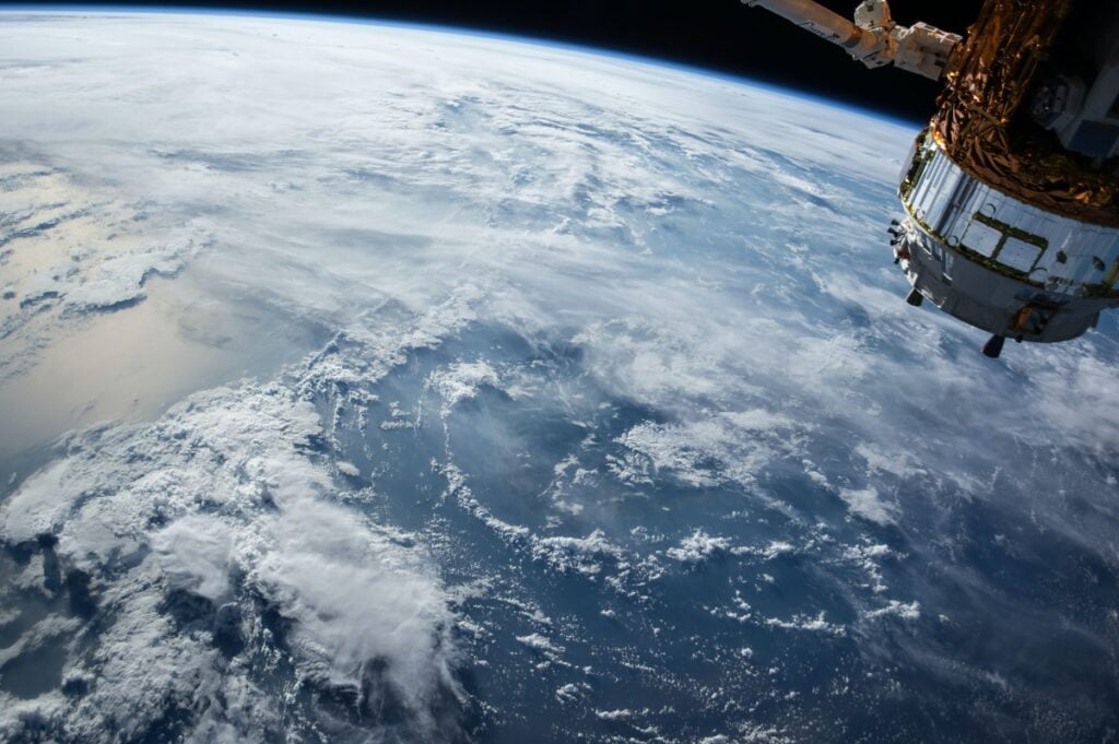 Ocean clouds seen from space. Photo by NASA via Unsplash