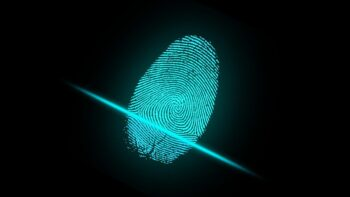 An illustrative photo of a fingerprint scan. Image by ar130405 from Pixabay