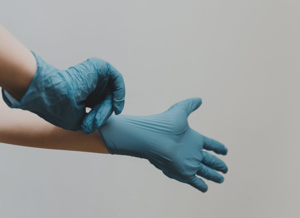 Surgeon gloves. Photo by Clay Banks on Unsplash